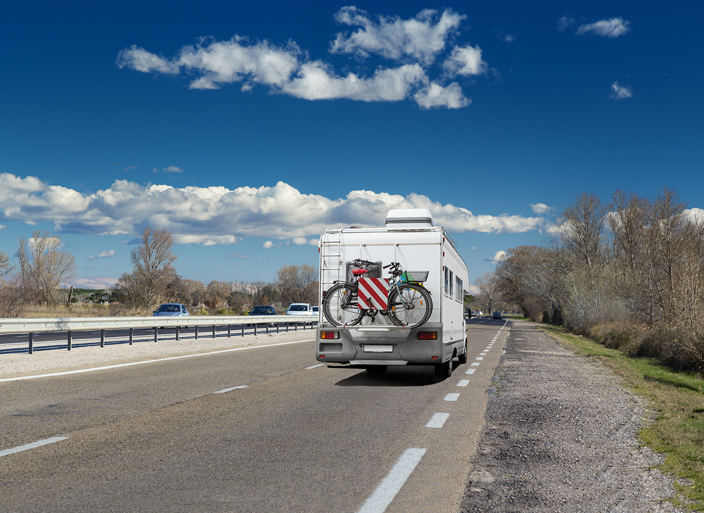RV traveling to campground on 4-lane highway
