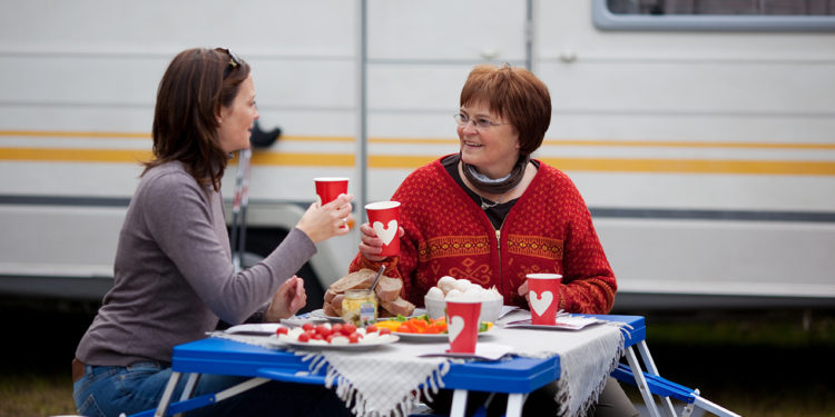 2 women at an rv campground picic table