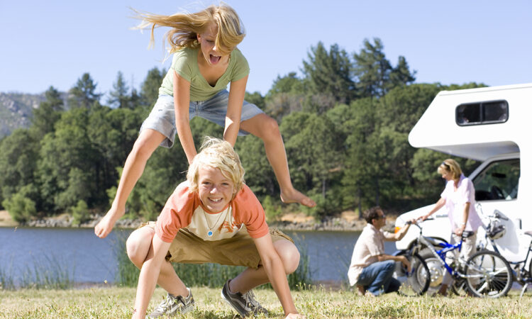 children play leapfrog at rv campground