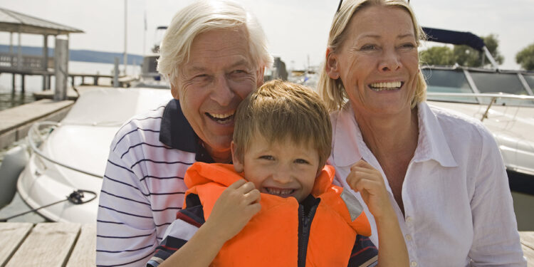 grandparents and grandson at lakeside marina
