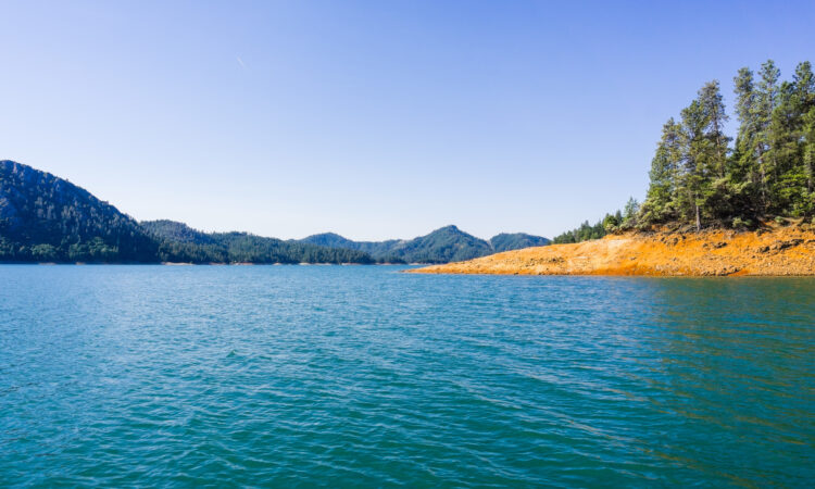 Shasta Lake, McCloud River Arm landscape on a sunny summer morning, Northern California