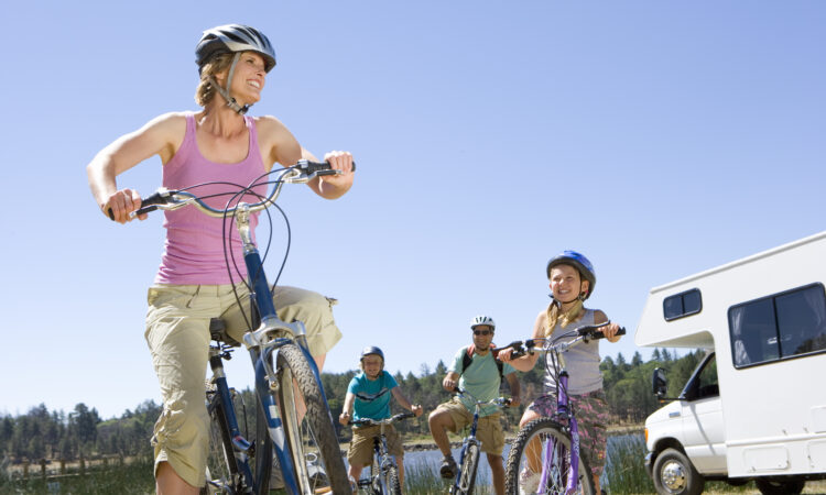 Family riding bikes while RV Camping